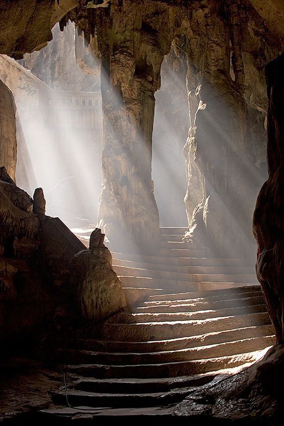 Sun shining into the entrance to the Khao Luang Cave temple, Phetchaburi, Thailand.